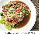green papaya spicy salad with... | Shutterstock . vector #724244209