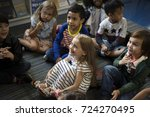 kindergarten students sitting... | Shutterstock . vector #724270495