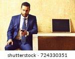 businessman with smartphone in... | Shutterstock . vector #724330351