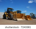 Two Pay Loaders At A...