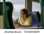 portrait of girl in train  | Shutterstock . vector #724345009