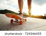 woman skateboarder... | Shutterstock . vector #724346455