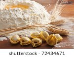 Tortellini pasta with wheat and flour - stock photo