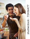 man in kitchen letting woman... | Shutterstock . vector #72436477