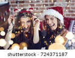 female friends winking and... | Shutterstock . vector #724371187