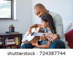 little girl and black father... | Shutterstock . vector #724387744