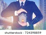businessman in suit holding... | Shutterstock . vector #724398859