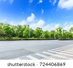 asphalt road and green forest | Shutterstock . vector #724406869