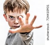 Small photo of fighting school kid defending himself against danger, stopping violence, aggression or abuse with hand forward, or acting like a bully or brat threatening preschooler,contrast effects,white background