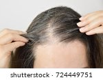 woman is checking white hair... | Shutterstock . vector #724449751