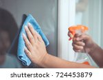 woman hand cleaning window with ... | Shutterstock . vector #724453879
