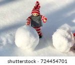 wooden toy with snowball | Shutterstock . vector #724454701