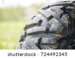 Small photo of Dirty protector tire ATV. Selective focus.