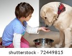 Stock photo cute child feeding his pet dog 72449815