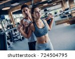 young couple is working out at... | Shutterstock . vector #724504795