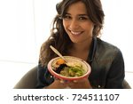 woman eating a healthy bowl of...   Shutterstock . vector #724511107