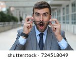 surprised man with glasses... | Shutterstock . vector #724518049