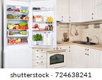 open refrigerator filled with... | Shutterstock . vector #724638241