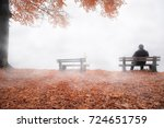 man on bench shrouded by mist... | Shutterstock . vector #724651759