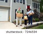 A Family Moves Boxes Into A Ne...