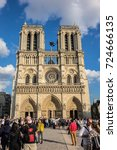 Small photo of PARIS, FRANCE - SEPTEMBER 2, 2017: Tourists visiting the Cathedral Notre Dame de Paris - most famous Roman Catholic cathedral (1163 - 1345) on the eastern half of the Cite Island.