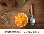 bowl with mashed sweet potato... | Shutterstock . vector #724671319