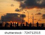 sunset silhouette of fishermen... | Shutterstock . vector #724712515