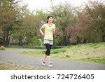 japanese sportswoman running in ... | Shutterstock . vector #724726405