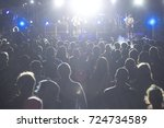 rear view of crowd with arms... | Shutterstock . vector #724734589