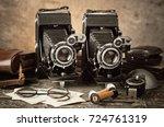 old camera | Shutterstock . vector #724761319