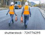 cone worker asphalting | Shutterstock . vector #724776295