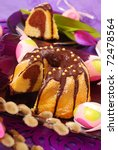 marble ring cake  poured with chocolate on easter table in purple color - stock photo
