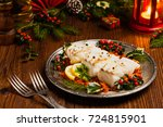 christmas fish. roasted cod... | Shutterstock . vector #724815901