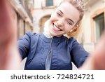 beautiful tourist woman hands... | Shutterstock . vector #724824721