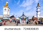 MUNICH, GERMANY - SEPTEMBER 25: people and fairground rides at the biggest folk festival in the world - the octoberfest on september 25, 2017 in munich. - stock photo