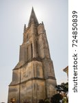 Small photo of the bell tower of monolithic church at Saint Emilion, Gironde, France