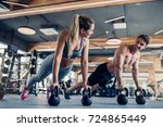 young couple is working out at... | Shutterstock . vector #724865449