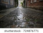 small beautiful alley with wet... | Shutterstock . vector #724876771