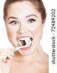 beautiful girl brushing her... | Shutterstock . vector #72489202