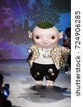 Small photo of NEW YORK, NY - SEPTEMBER 10: Cute little monster Wuba walks the runway wearing Vivienne Tam Spring 2018 during New York Fashion Week on September 10, 2017 in New York City.