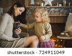 Stock photo mother and daughter are playing with kitten 724911049