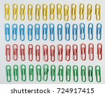 color paper clips on a gray... | Shutterstock . vector #724917415