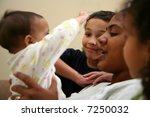 a mother with her children | Shutterstock . vector #7250032