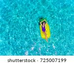 top aerial view of a woman... | Shutterstock . vector #725007199
