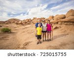 family hiking together among... | Shutterstock . vector #725015755