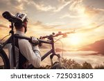 mountain biker overlooking a... | Shutterstock . vector #725031805