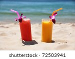 Pair of fruit shakes on the tropical beach - stock photo