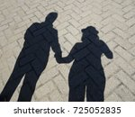 shade of couple holding hands