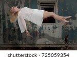 beautiful young woman floating... | Shutterstock . vector #725059354