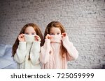 the red haired twins hiding in... | Shutterstock . vector #725059999